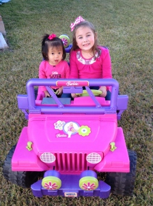 Amelia is content with always riding shotgun, she will just sit in the jeep waiting for Big Sis to take her for a ride.