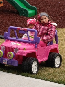 They LOVE riding around the yard in this jeep!