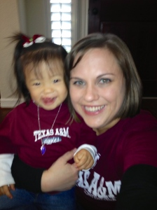 Our little Aggie helped to cheer the team on Friday night!  (and yes I chopped my hair off...11 inches for Wigs for Kids!)